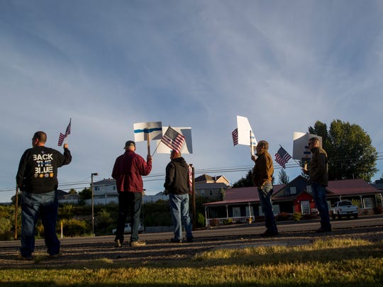 Community members take part in a rally against a recently adopted constitutional amendment Tuesday in Aztec.
