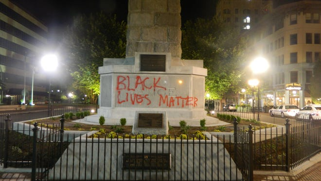 Asheville resident Robert Lane mentioned the Vance Monument as an example of how white, powerful figures have historically dominated public art. Here, the monument is shown with graffiti in June 2015. It was promptly cleaned.