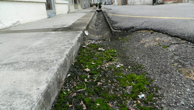 The last phase of Erin's Court Square revitalization project will cover an open drainage ditch between the parking lot and sidewalk at the west end.