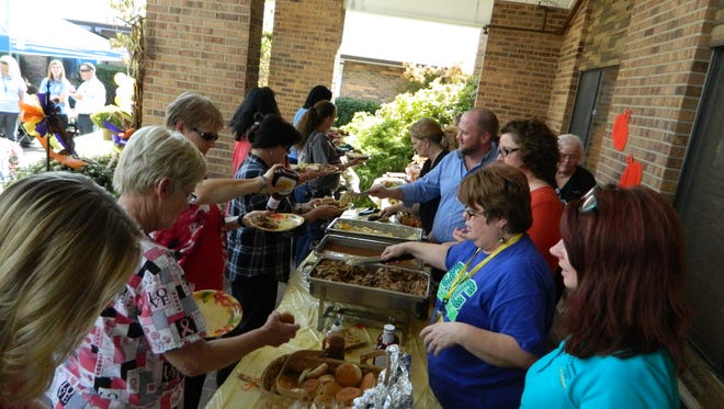 A picnic lunch of barbecue was served up to residents and staff of the nursing home, as well as for visitors from other Signature facilities.
