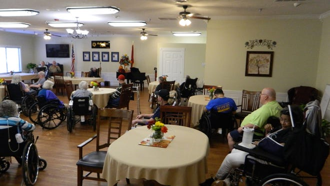 Residents at Signature HealthCARE in Erin gathered recently in the dining hall for a musical program.