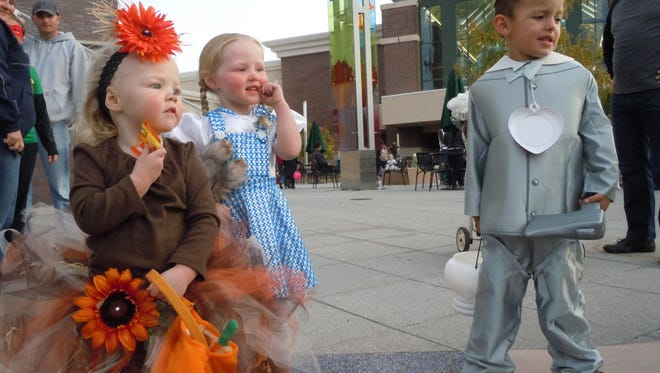 Trick-or-treaters gather before embarking for candy.