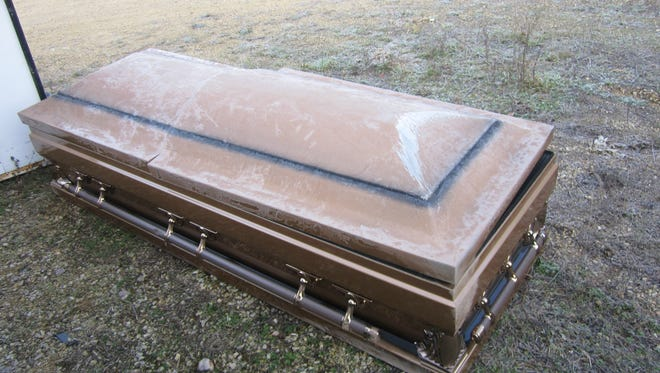 Deputies found this casket on the side of the road in the Adams County town of Quincy.