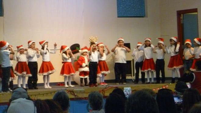 """Bataan Elementary kindergarten students from Cecilia Price's class rocked the gym when they performed """"Rodolpho la Rena"""" and """"Navidad Rock"""" during the Winter Concert. Music teacher and coordinator of the program, Ashley Beraun, would like to give a special thanks to Larry Martin and the DHS Choir, all of the classroom teachers and educational assistants who helped with the preparations and performances, principals and all of the Bataan families who attended."""
