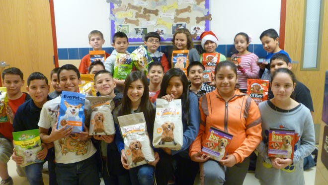 Bataan Elementary School fifth grade students collected dog and cat food for the Deming Animal Shelter as a community service project. The fifth grade teaching team of Jimmy Mondragon, Judy Marrufo, Gina Simms and Kim Perea wanted students to practice the gift of giving without getting something in return. The students collected approximately 275 pounds of dry food, 34 cans of pet food, and various items, including bowls, toys, towels, blankets and a small bed.