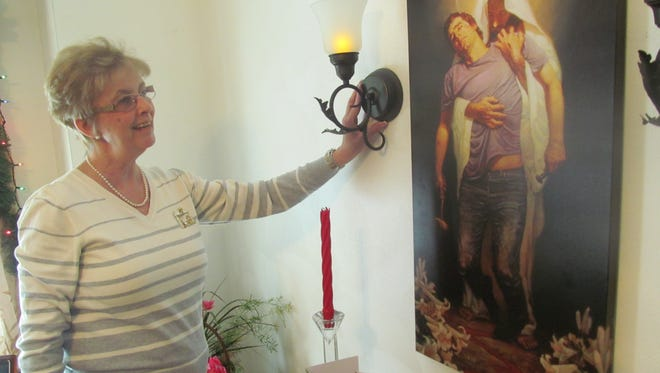 Becky Monforte recently retired as a church secretary after more than 30 years of service. She was given a picture of Jesus as a retirement gift.