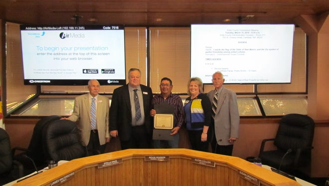 Alfredo Parraz, of the Eddy County public works department, receives a service award.