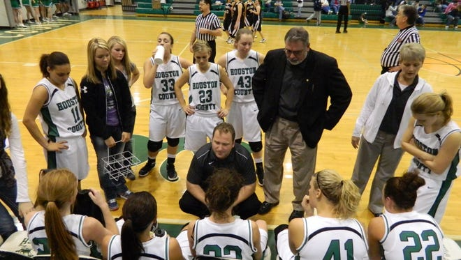 Houston County head basketball coach Sam Young, center, talks with his team during a game against Big Sandy in 2012.