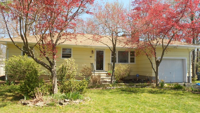 This three-bedroom ranch has a new kitchen remodeled this year, and a large backyard with a deck and patio. It also has a finished basement.