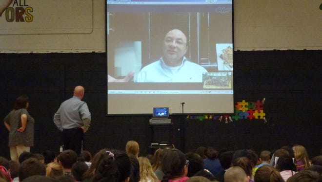 The third- and fourth-graders at Kennedy School learned what it's like to travel to the International Space Station when their teacher set up a Skype lesson with Mark Polansky, a former NASA astronaut.