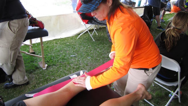 Christine Scarano performing physical therapy at the New Jersey Marathon last month.