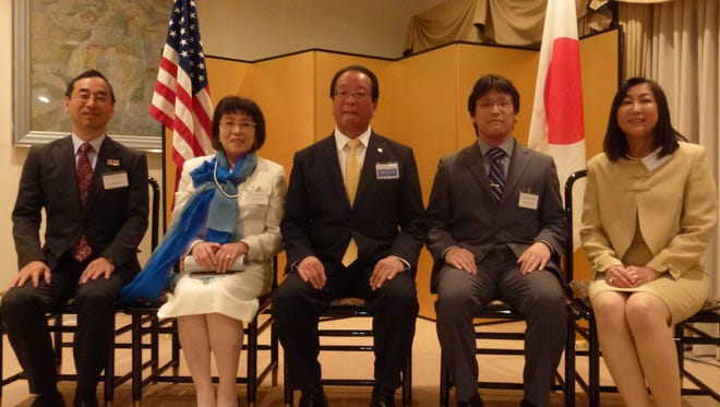 From left to right: Consul-General Mitsuhiro Wada, Mrs. Atsuko Tagawa, Mr. Yoshiteru Tagawa, Mr. Terumuni Tagawa, and Mrs. Naoko Wada. Tarawa received a commendation for his work in the kendo martial arts and his generosity in helping others learn the art form.
