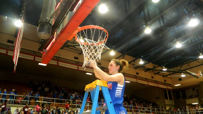 Justiss Cantu of Union City cuts down the nets after her 36 points led the Indians to a 69-64 double overtime victory over Marquette Catholic to win the IHSAA Class A semistate championship at Logansport Saturday, Feb. 18, 2017.