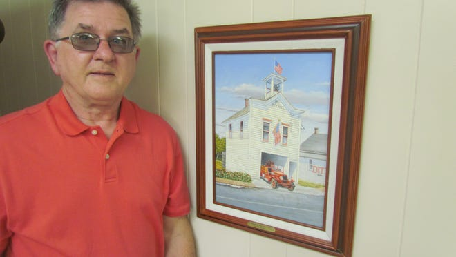 "In the spirit of Flag Day, Ron Etzel of Sublimity shared stories about the 105-year-old flagpole erected in his yard. The pole once towered above the belfry of the historical Sublimity City Hall built in 1912. The adjacent artwork that depicts that pole in its original use is ""Sublimity City Hall 1931"" painted by Bob Hartmann."