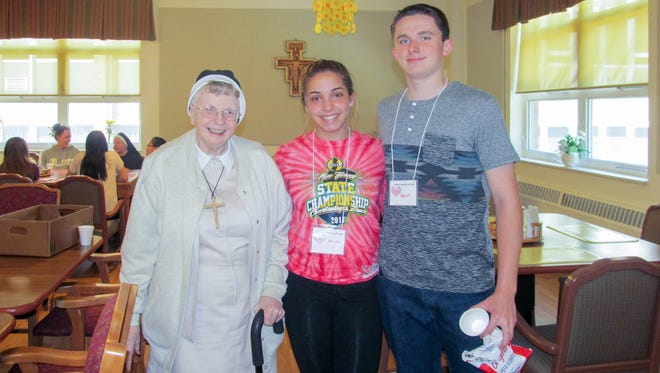 Sr. Adele, Melina Colasanti and Kevin O'Neil after sharing lunch in June.