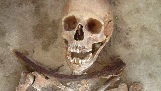 This skeleton unearthed in a centuries-old Polish graveyard was buried with a sickle around the neck, possibly to prevent the corpse from rising out of the grave as a member of the undead. The skeleton belonged to a woman in her 30s.