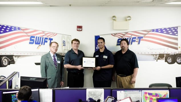 The Office of the Secretary of Defense Employer Suppport of the Guard and Reserves recently recognized Michael Schramm of Swift Transportation in Union Township as a patriotic employer for supporting employee participation in America's National Guard and Reserves. Schramm was nominated for the award by Pfc. Carlos Marquez, who is a shop technician at Swift. Pictured are, from left, George Mentzer, south central area representative of ESGR; Schramm, HR/recruiter at Swift; Marquez; and Dan Roy, terminal manager at Swift.