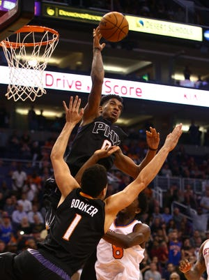 Dec 13, 2016: Phoenix Suns forward Marquese Chriss (0) blocks a shot against the New York Knicks at Talking Stick Resort Arena. The Suns defeated the Knicks 113-111 in overtime.