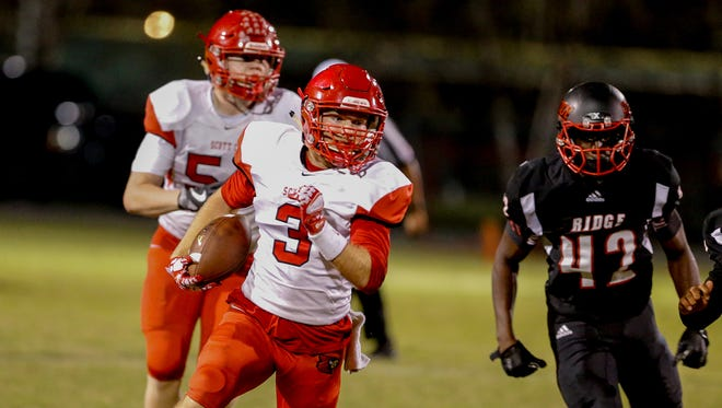 Scott Co. running back Brice Fryman (3) gets some space aginst the PRP defense on Friday, Oct. 20, 2017