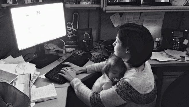 This is Leigh's favorite work photo. Her daughter, who is now 2, fell asleep on her when she was working one night in March on a story about Louisiana College.
