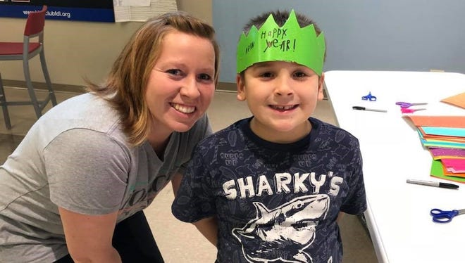 Jenny Averbeck, left, and her son, Garen, enjoyed creating a fun make-and-take headband as part of the New Year's Eve festivities at the Boys & Girls Club and YMCA in Fond du Lac.
