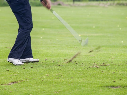 Hitting a ball out of a divot on the course can be