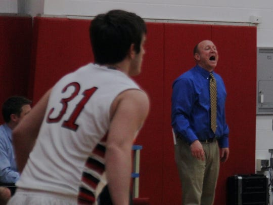 Highlands head coach Kevin Listerman shouts to his