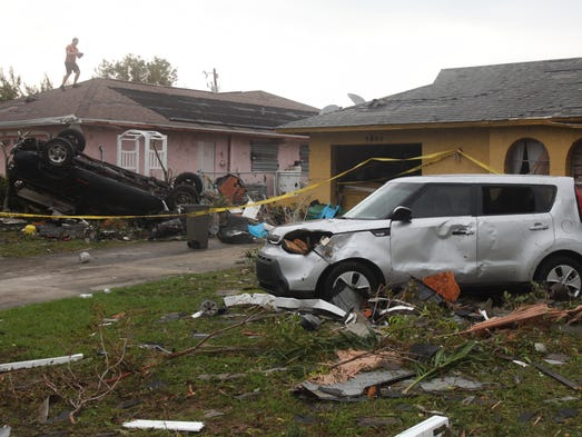 Cape Coral residents assess the damage to homes on