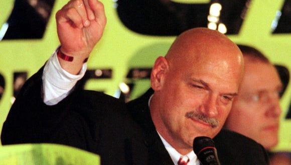 Minnesota governor-elect Jesse Ventura signals number