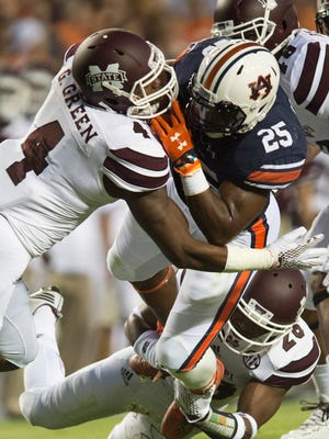 Mississippi State linebacker Gerri Green (4) tackles Auburn running back Peyton Barber (25) during the NCAA football game between Auburn and Mississippi State on Saturday, Sept. 26, 2015, at Jordan-Hare Stadium in Auburn, Ala. 