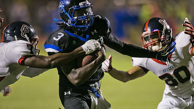 Centennial's Amare Burks, left, and Justin Ackie chase Chandler's Bryce Perkins at Chandler High School on Aug. 29, 2013, in a high school football game.