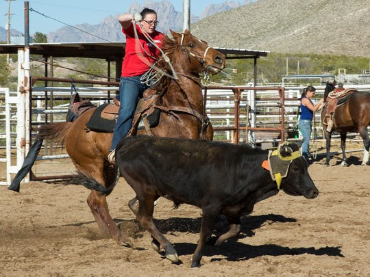 Deena Norell, practices team roping at the New Mexico