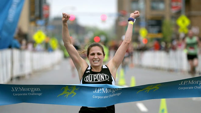 Trisha Byler won the women's division of the J. P.  Morgan Corporate Challenge with a time of 21:16.