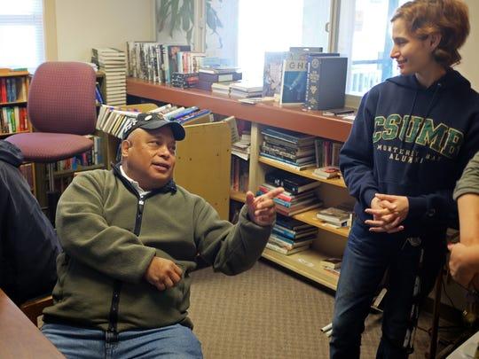 Program graduate Joseph Aguero discusses housing prices with staffer  Aubrey Madrigal at the Veterans Transition Center in Marina.