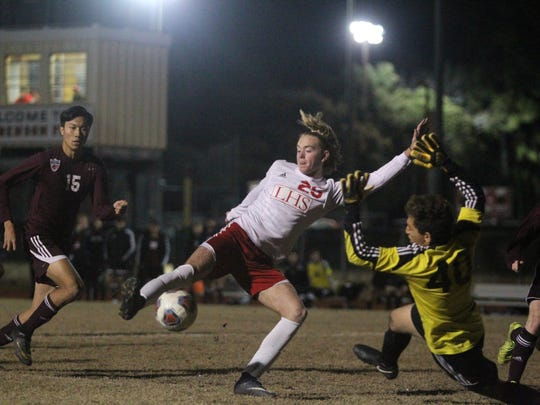 Leon sophomore Nick Ramsden knocks in a goal as Chiles