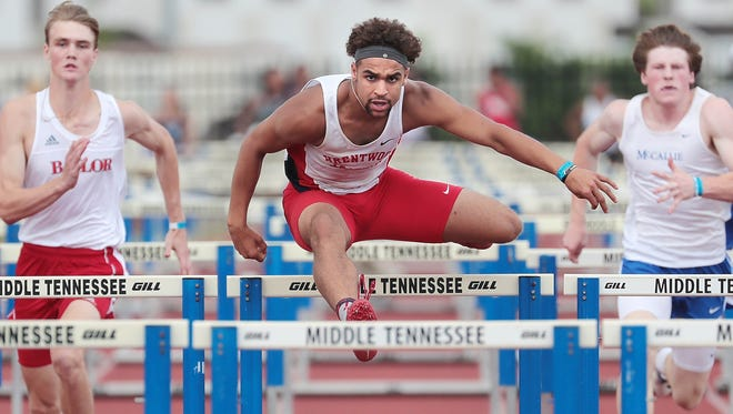 Camron Johnson from Brentwood Academy competes in the 110 Hurdles during the Division II Track and Field Tournament Friday at Spring Fling in Murfreesboro.