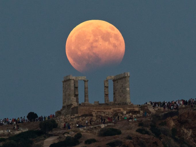 The August full moon rises above the 5th Century BC