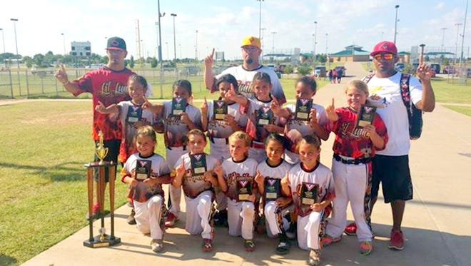 """Carlsbad's Lil Lumbre 8U travel softball team took first place at """"The Goliath"""" tournament last Sunday in Lubbock, Texas. Lil Lumbre played 15 games over four days and was one of 17 8U teams in the tournament. Bottom row from left: Emily Galindo, Makayla Chester, Parris Weldon, Harmony Kamalani, Cayley White. Top row from left: Tristan Hernandez, Kalion Fuentes, Hannah Navarrette, Saryah Dominguez, Richanna Saiz, Addison Arredondo. Coaches: Jacob Dominguez, Cy McCravey, Jonathan Fuentes."""