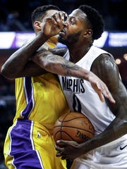 Memphis Grizzlies JaMychal Green (right) is fouled by Los Angeles Lakers defender Larry Nance Jr. (left) during second quarter action at the FedExForum in Memphis, Tenn., Monday, January 15, 2018.