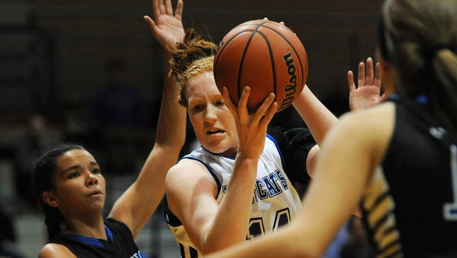 North Harrison's Lilly Hatton (center) looks to shoot against Charlestown on Saturday at North Harrison High School. (Photo by David Lee Hartlage, Special to The Courier-Journal) Nov. 12, 2016