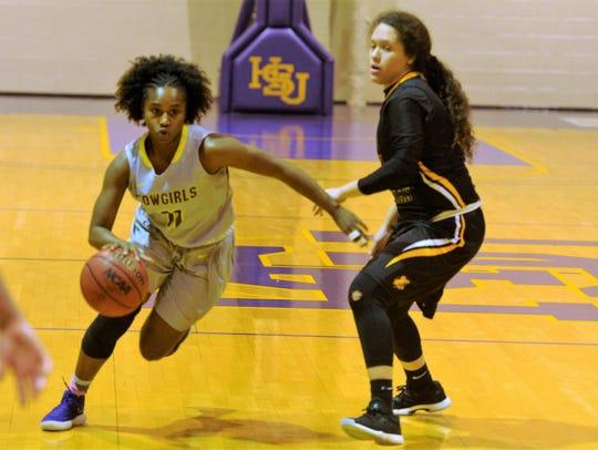 Hardin-Simmons guard Jasmine McClellan drives past