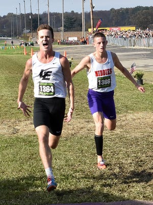 Lakota East's Duston Horter makes his last stride to the finish line tightly followed by Conant Smith of Middletown at the 2017 OHSAA Cross Country Championships in Hebron, Ohio, Nov. 4, 2017