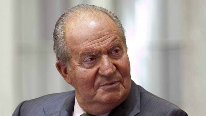 In this Friday, June 13, 2014 file photo, King Juan Carlos of Spain attends the commemorating the 25th anniversary of SECOT at El Pardo Palace in Madrid, Spain.