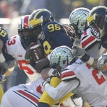Michigan's Devin Gardner is sacked late in the second quarter of their football game against Ohio State in Ann Arbor on Saturday, November 30, 2013. Julian H. Gonzalez /Detroit Free Press