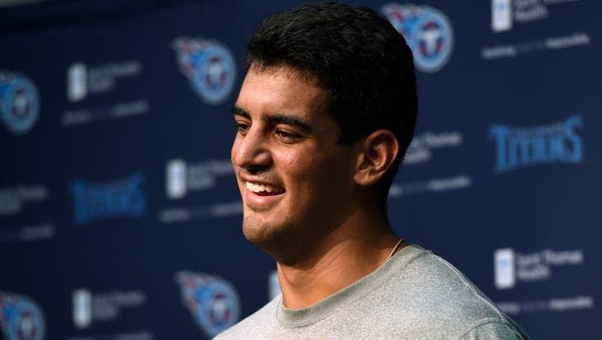 Titans quarterback Marcus Mariota shares a laugh with the media when asked about his surfboarding skills at St. Thomas Sports Park before the start of training camp Thursday July 30, 2015, in Nashville, Tenn.
