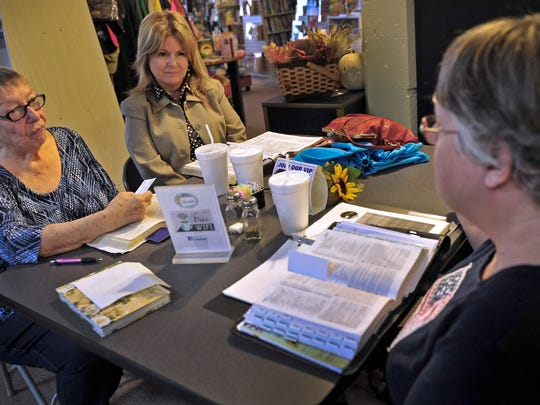 Jean Amerud, left, Valerie Heinze and Donna Bunch hold a Bible study at The Lunch Box restaurant in Ashland City. The town has been 95 percent white for half a century.