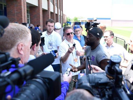 New York Giants safety Michael Thomas tells the media