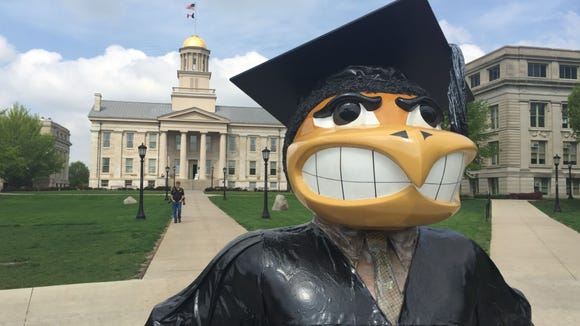 A Herky sculpture stands near the Old Capitol on the
