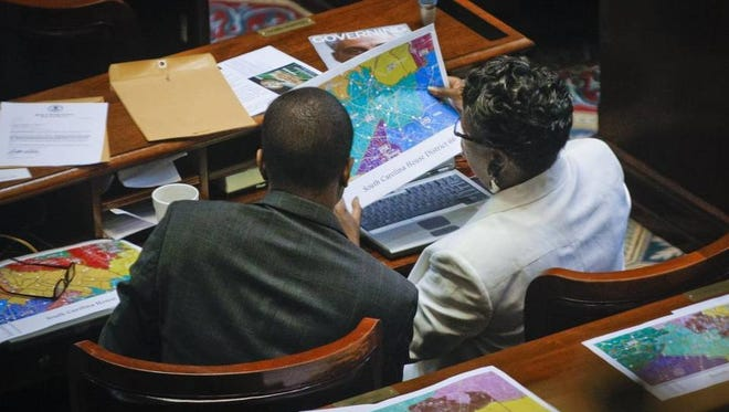 Rep. Bakari Sellers, D-Bamberg, left, and Rep. Gilda Cobb-Hunter, D-Orangeburg, right, look at redistricting maps.