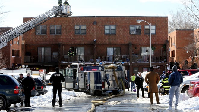 Firefighters work at the scene of an apartment fire in a complex at 145 Fred Hecht Drive in Spring Valley March 16, 2017. The fire, which started late morning, started in the basement and worked its way up into one apartment. One family was left homeless. No injuries were reported.